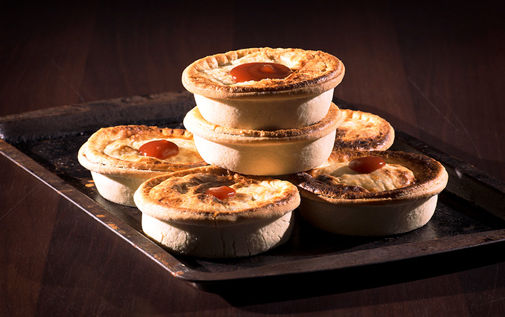 Pies stacked on tray